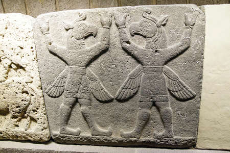 orthostat: Bird headed winged figures, Griffin Demons carry the heavens, Orthostat of Procession in Kargamis near Gaziantep, 900-700 BCE Museum of Anatolian Civilization,  Ankara, Turkey