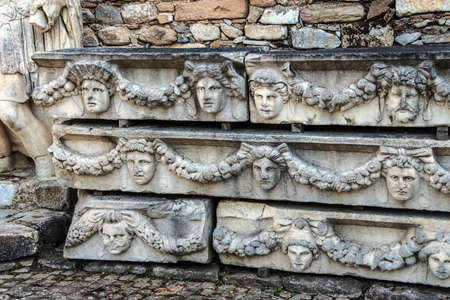 Rows of sculpted Greek masks  recovered from the ruins of the theatre of  Aphrodisias,  Turkey photo