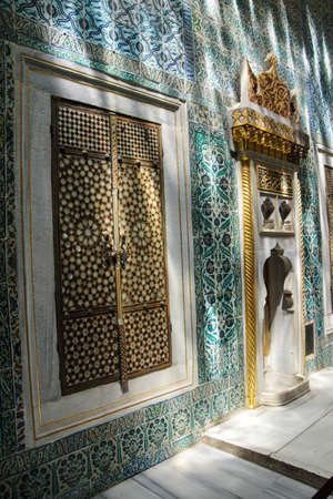 inlay: Inlaid doors and mosaic tiles  in dappled shadows  in the Harem  in Topkapi Palace,  in Istanbul, Turkey