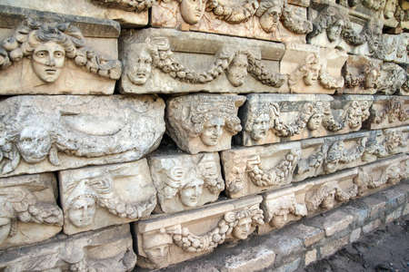 thespian: Rows of sculpted Greek masks  recovered from the ruins of the theatre of  Aphrodisias,  Turkey Stock Photo