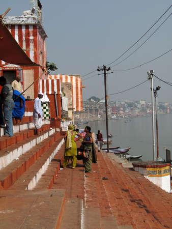 VARANASI, INDIA - NOV 7 - Hindu pilgrims climb the steps of a Shiva temple  on the Ganges bank on Nov 7, 2009, in Varanasi, India...