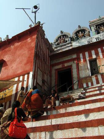VARANASI, INDIA - NOV 7 - Hindu pilgrims climb the steps of a Shiva temple  on the Gabges bank on Nov 7, 2009, in Varanasi, India.