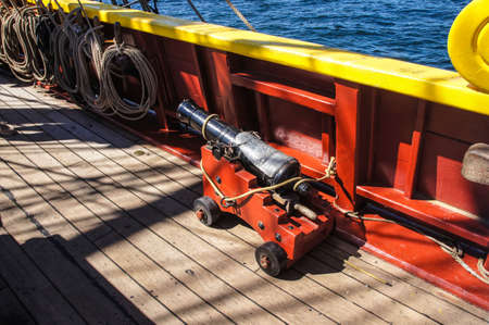 ketch: Small naval cannon on board  historical wooden brig Stock Photo