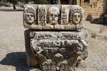 Carved Greek masks as decoration from the theatre of of Myra,  Turkey photo