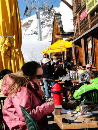 soleil: CHATEL, FRANCE - FEB 27, 2012 - Skiers enjoy lunch outdoors in the sun   at the tiny village of Les Lindarets  in the Portes du Soleil, France