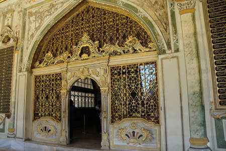 divan: Golden grill gate to the Sultans Divan  in Topkapi Palace,  in Istanbul, Turkey Editorial