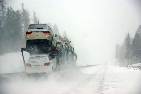 Large trucks fight a winter storm on the mountain highway in Eastern Oregon