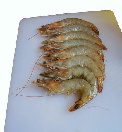 Raw shrimp, on cutting board, being pepared for dinner Stok Fotoğraf
