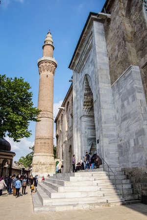 Brick minaret of the Ulu Cami  outside the bazaar of  Bursa, Turkey