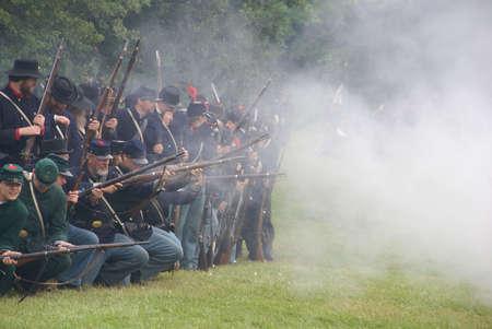 PORT GAMBLE, WA - JUN 20: Civil War reenactors participate in a mock battle. Union infantry line firing a volley. Stock Photo - 32116733