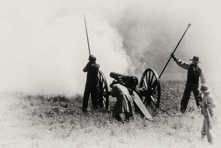 Confederate artillery firing,duringCivil War battle reenactment Editorial