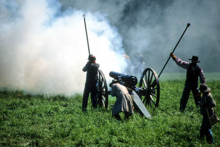 Confederate artillery firing duringCivil War battle reenactment Stock Photo