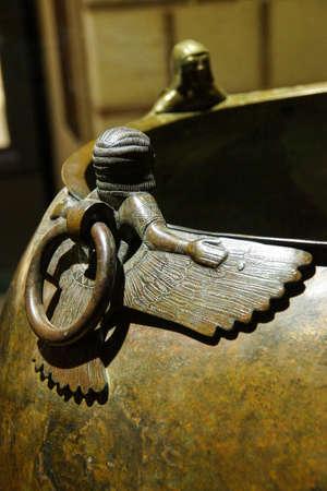 Mythical winged figures on bronze cauldron, Gordion civilization from Kazan, 8th c BCE,  Museum of Anatolian Civilization,  Ankara, Turkey Editorial