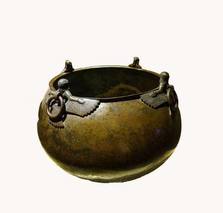 Mythical winged figures on bronze cauldron, Gordion civilization from Kazan, 8th c BCE,  isolated on white, Turkey