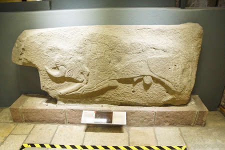 ANKARA, TURKEY - MAY 21, 2014 -   Andesite relief of bull from Alaca, Corum, 1400 BCE,  Museum of Anatolian Civilization,  Ankara, Turkey