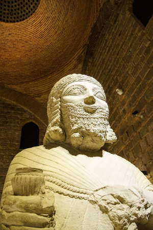orthostat: ANKARA, TURKEY - MAY 21, 2014 -  Statue of King Mutallu, subject to Sargon II of Assyria, 1200 - 700 BCE, Aslantepe in Malatya,  Museum of Anatolian Civilization,  Ankara, Turkey