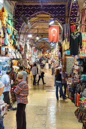 ISTANBUL - MAY 17, 2014 - Shoppers explore the maze of the Grand Bazaar (Kapali carsi ) in Istanbul, Turkey
