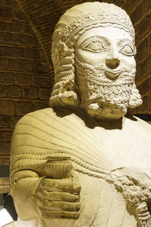 ANKARA, TURKEY - MAY 21, 2014 -  Statue of King Mutallu, subject to Sargon II of Assyria, 1200 - 700 BCE, Aslantepe in Malatya,  Museum of Anatolian Civilization,  Ankara, Turkey