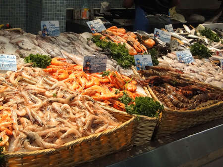 Fresh shrimp and calamari  in the market of  Les Halles, Avignon, France