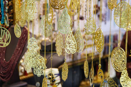 Gold and sikver jewelry on display  in the Grand Bazaar (Kapali carsi ) in Istanbul, Turkey photo