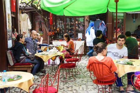 SAFRANBOLU, TURKEY - MAY 19, 2014 - Tourists relax in an outdoor coffee shop in  Safranbolu, Turkey Editorial