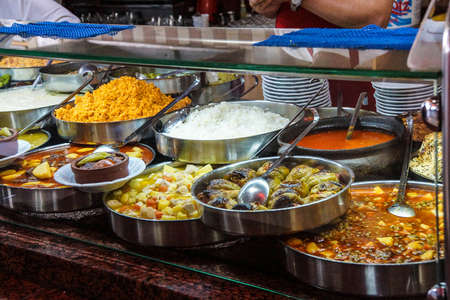 Buffet lunch in Turkish restaurant  of bulgur, coos coos, peppers, stews, soup and meat dishes, near  Pergamum, Turkey