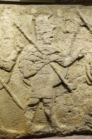 orthostat: ANKARA, TURKEY - MAY 21, 2014 -  Detail, soldier carrying spear from Kargama about 800 BCE,  Ankara, Turkey