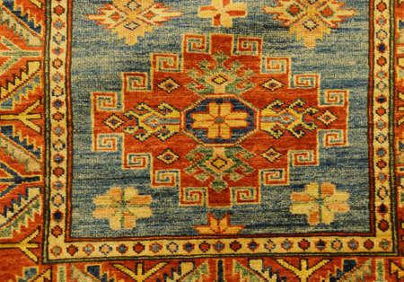 Details of intricate blue patterns in Turkish carpets  in rug store  inGoreme, Cappadocia, Turkey