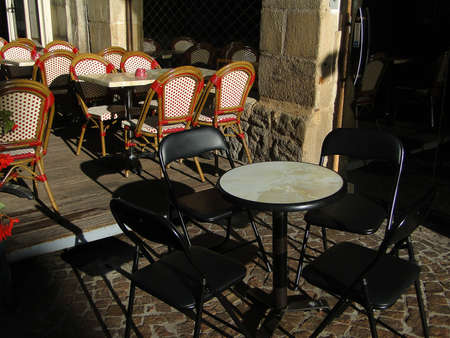 Tables and chairs  for outdoors dining in Figeac, France