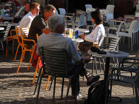 FIGEAC, FRANCE - SEP 22 - Evening diners relax in an outdoor restaurant on Sep 22, 2011  in Figeac, France