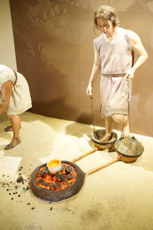 orthostat: ANKARA, TURKEY - MAY 21, 2014 -  Statue showing metal working in prehistoric times,  Ankara, Turkey