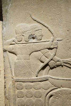 orthostat: ANKARA, TURKEY - MAY 21, 2014 -  Chariot with driver and archer. Orthostat stele from Kargama about 800 BCE,  Ankara, Turkey