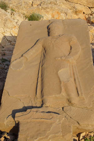 Orthostat sculpture, fallen on the ground,  tumulus of Nemrut Dag,  in southeastern Turkey Stock Photo