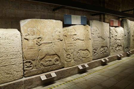 orthostat: ANKARA, TURKEY - MAY 21, 2014 -  Hallway, Chariot with driver and archer, Orthostat stelesfrom Kargama about 800 BCE,  Ankara, Turkey