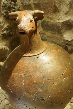 civilization: ANKARA, TURKEY - MAY 21, 2014 -  Bull head pithos pitcher, 2500 years old,  Museum of Anatolian Civilization,  Ankara, Turkey