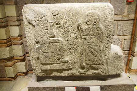 worshipper: ANKARA, TURKEY - MAY 21, 2014 -  God and worshipper  from  Alaca, Corum, 1400 BCE Museum of Anatolian Civilization, Ankara, Turkey