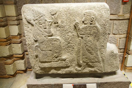 ANKARA, TURKEY - MAY 21, 2014 -  God and worshipper  from  Alaca, Corum, 1400 BCE Museum of Anatolian Civilization, Ankara, Turkey