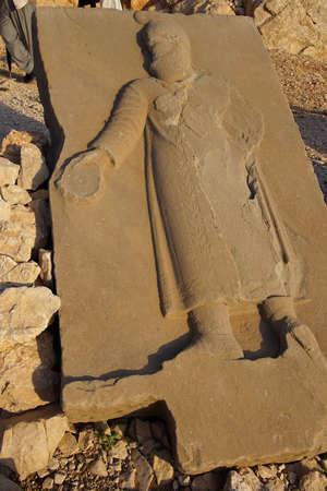orthostat: Orthostat sculpture, fallen on the ground,  tumulus of Nemrut Dag,  in southeastern Turkey Editorial