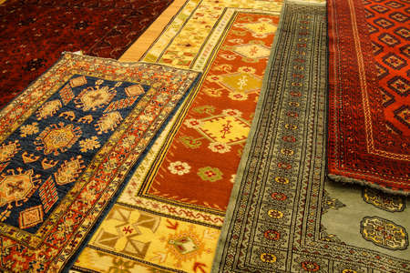 red carpet background: Details of hand woven carpets  in rug store  Ephesus, Turkey