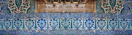 iznik: Iznik lapis  tiles with tulip pattern on a wall  in the Harem  in Topkapi Palace,  in Istanbul, Turkey Stock Photo