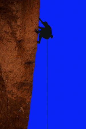 smith rock: Silhouette off climber on sheer cliff of Monkey Face, Smith Rock State Park, Central Oregon Stock Photo