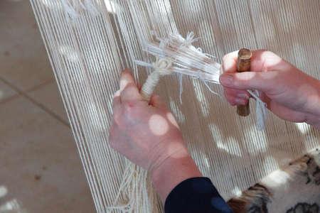 Weaving a Turkish carpet on a loom,  Ephesus, Turkey
