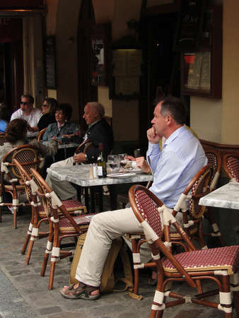 PARIS - SEP 12, 2011 - Diners enjoy a lunch at an outdoor bistro  on Sep 12, 2011, in Paris, France. Editöryel