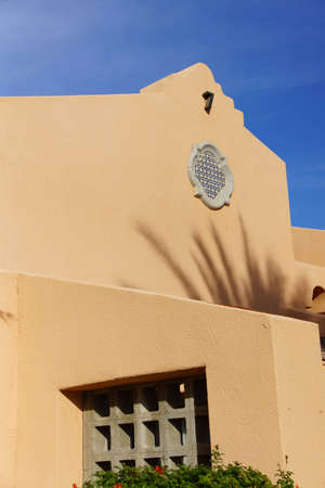 a mirage: Southwestern architecture, spanish  style building with blue desert sky,  Rancho Mirage, California Stock Photo