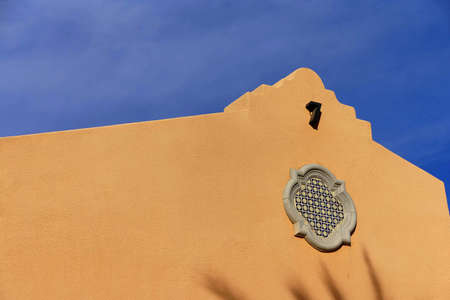 a mirage: Southwestern architecture, spanish adobe style building with blue desert sky,  Rancho Mirage, California