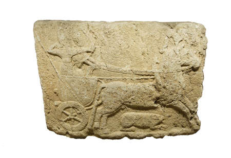 ANKARA, TURKEY - MAY 21, 2014 -  Chariot with driver . Orthostat stele  from  Alaca, Corum, 1400 BCE Ankara, Turkey Editorial