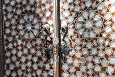 marquetry: ISTANBUL, TURKEY  - MAY 18, 2014 -   Detail panel of  mother of pearl inlays  in the Harem  in Topkapi Palace,  in Istanbul, Turkey