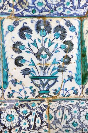 iznik: ISTANBUL - MAY 18, 2014 -   Iznik lapis  tiles with tulip pattern on a wall  Courtyard of the Favorites Harem of  Topkapi Palace, in Istanbul, Turkey
