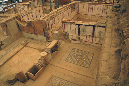 revealed: EPHESUS, TURKEY - MAY 25, 2014 -  Excavations by archaeologists have revealed painted Roman frescoes on the walls of private homes on the terraces above  Ephesus, Turkey