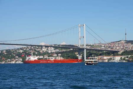 tanker ship: ISTANBUL - MAY 18, 2014 - Tanker ship passes under  the Bosphorus suspension bridge in Istanbul, Turkey Editorial